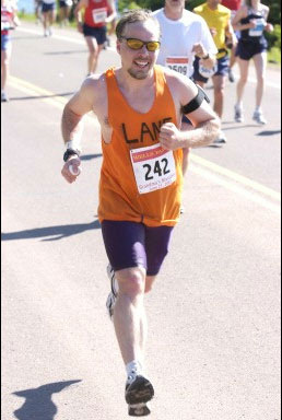 Lane R. Ellis at Knife River, Minnesota with a burst of speed during the 2003 Grandma's Marathon